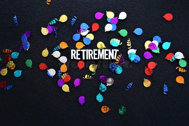 Retirement sparkly balloons glitter. Sparkles, confetti, and textured balloon metal foil surround the word Retirement in white block letters against black royalty free stock photo