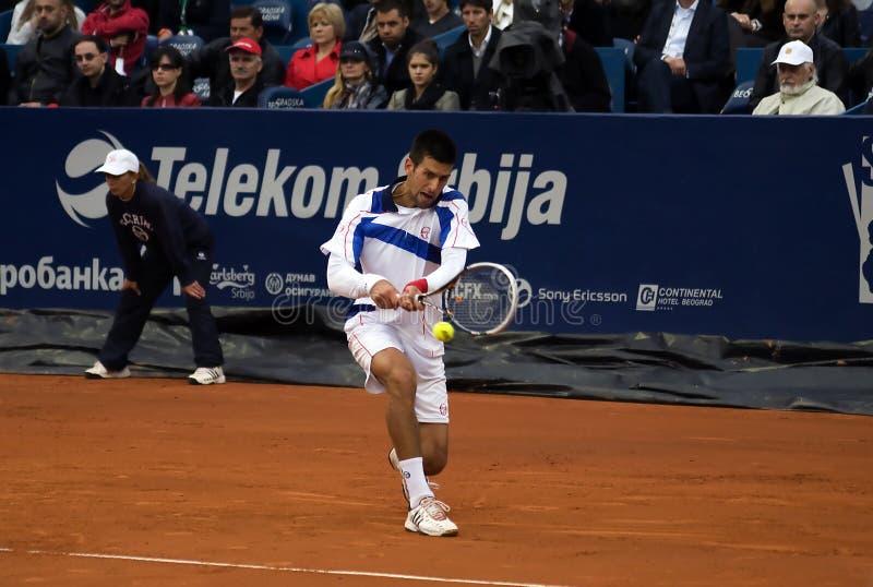 Retorno do jogador N.Djokovic um ball-1 fotos de stock royalty free