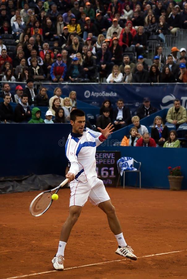 Retorno do jogador N.Djokovic um ball-2 imagens de stock