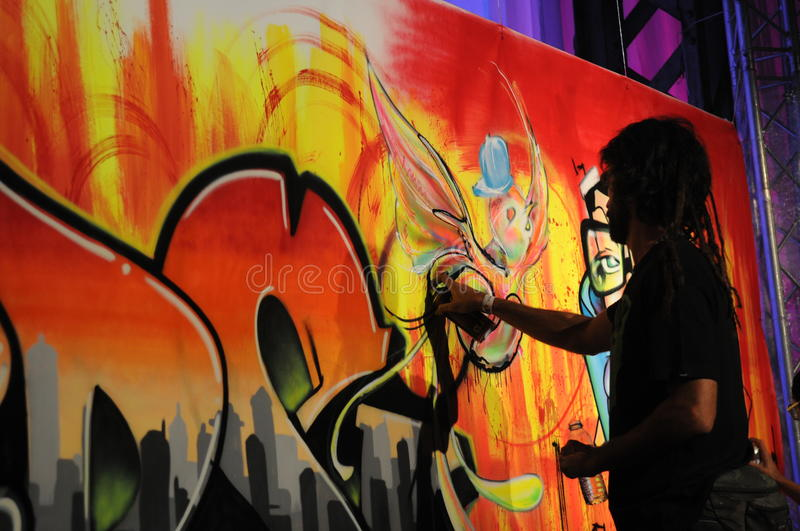Download Drawing With Can Spay - Graffito - Man Painting Editorial Stock Image - Image of drawing, drawings: 24507544