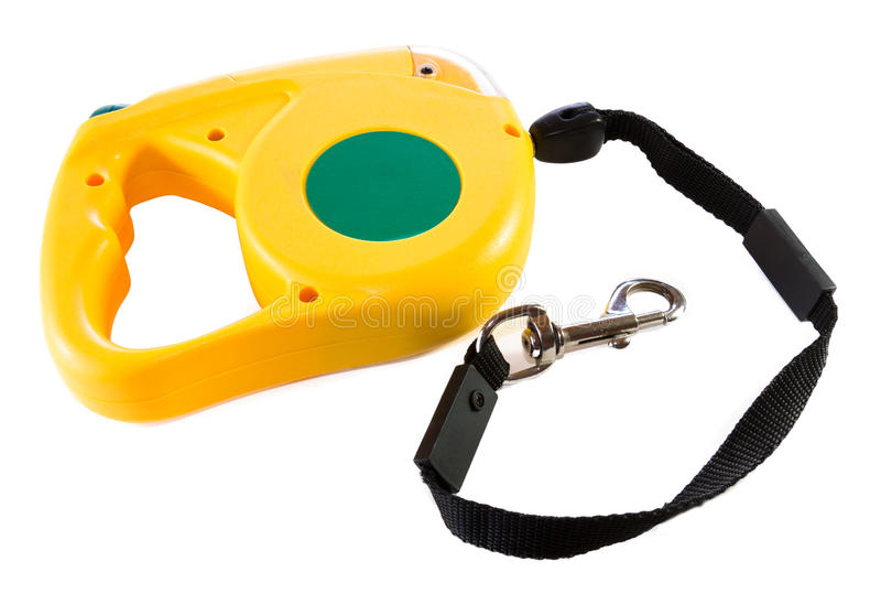 Retractable dog leash. A green and yellow retractable dog leash for walking royalty free stock photo