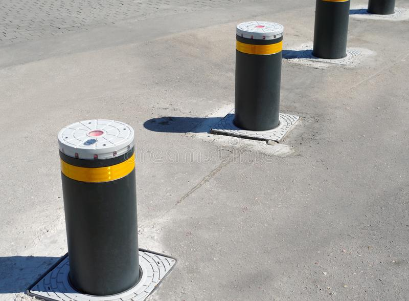 Retractable Electric Bollard Metallic, and hydraulic for the control of road traffic royalty free stock photos