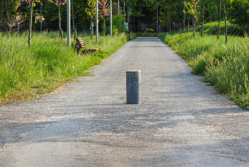 Retractable Electric Bollard Metallic, and hydraulic for the control of road traffic locked up underground royalty free stock images