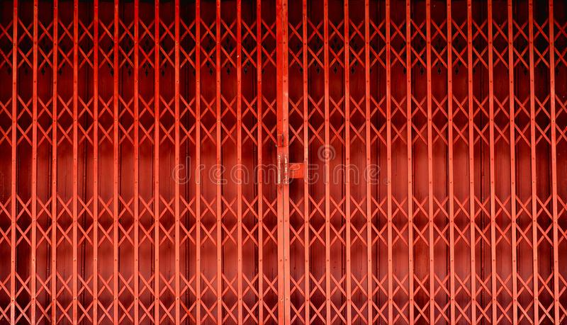 Retractable Folding Red Door Gate Stock Image - Image of shop, style ...