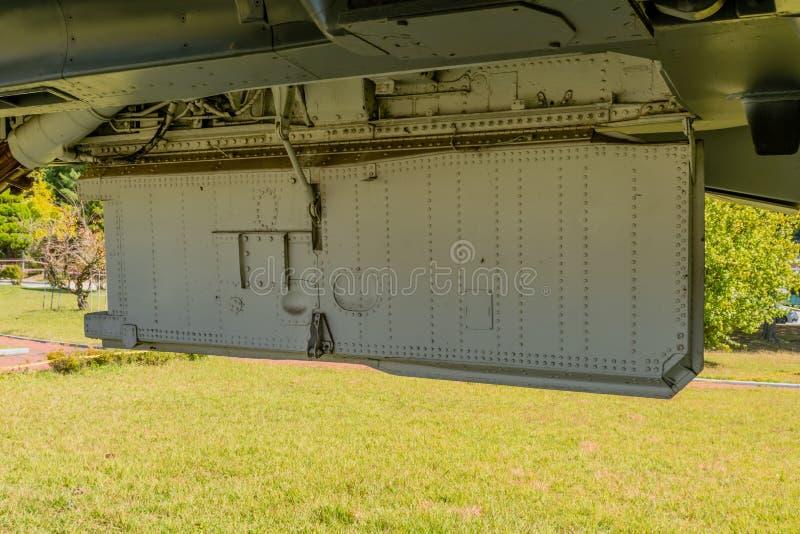 Retractable landing gear door. Retractable landing gear bay door on fighter jet on display at public park stock image