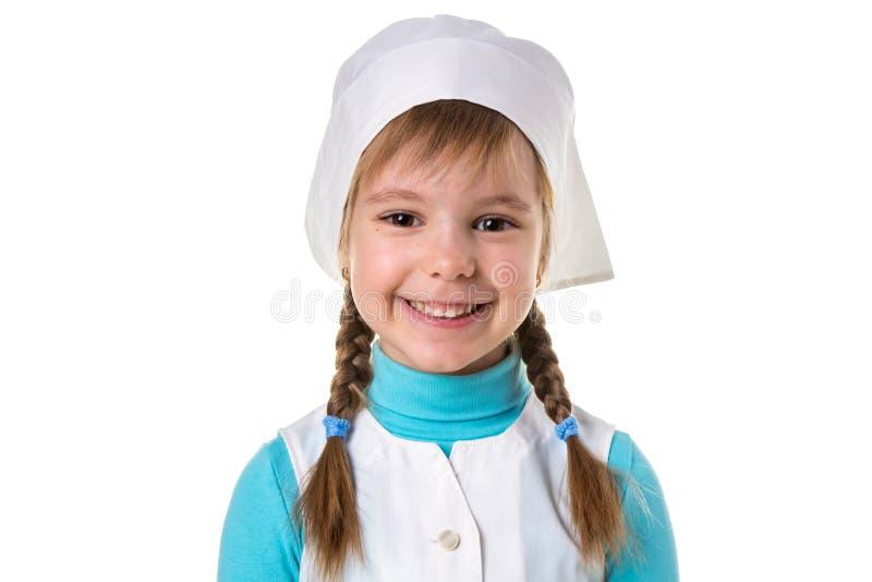 Retrato ascendente próximo da enfermeira ou do doutor fêmea de sorriso feliz alegre no uniforme médico, orientação da paisagem no fotografia de stock