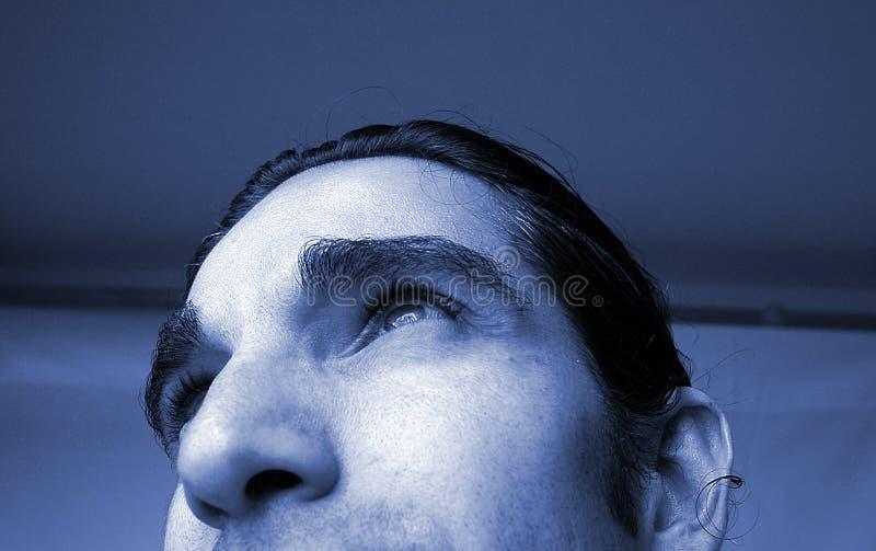 Retrato azul do homem imagem de stock