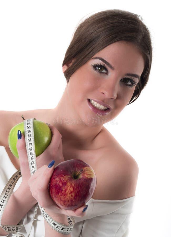 Retrato bonito da jovem mulher, conceito da dieta imagens de stock royalty free