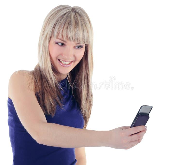 Retrato brilhante da mulher feliz com telefone de pilha foto de stock