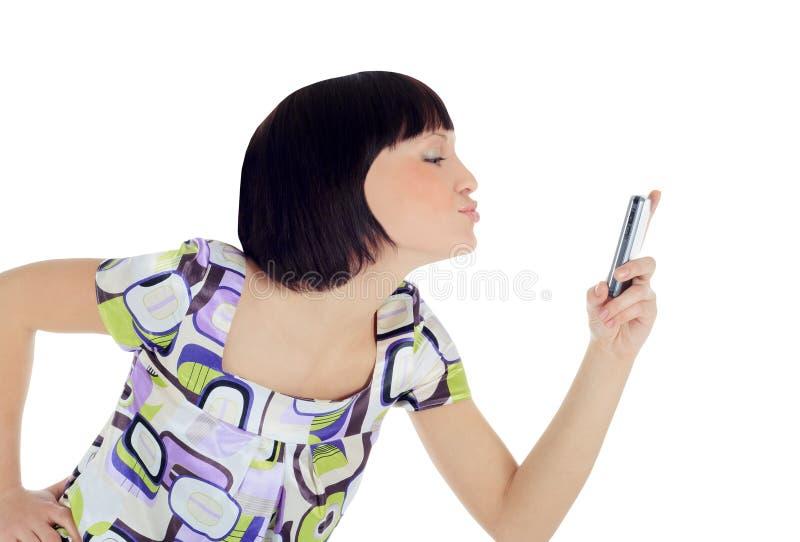 Retrato brilhante da mulher feliz com telefone de pilha imagem de stock