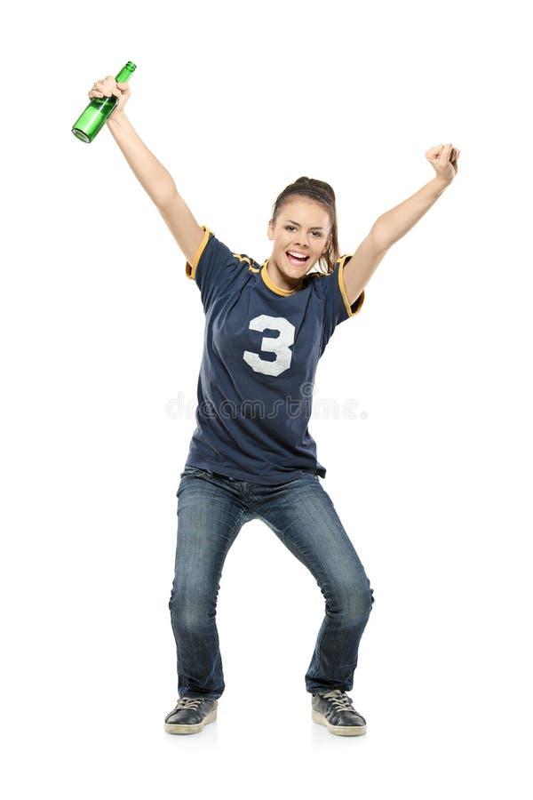 Retrato cheio do comprimento de um aficionado desportivo fêmea feliz fotografia de stock royalty free