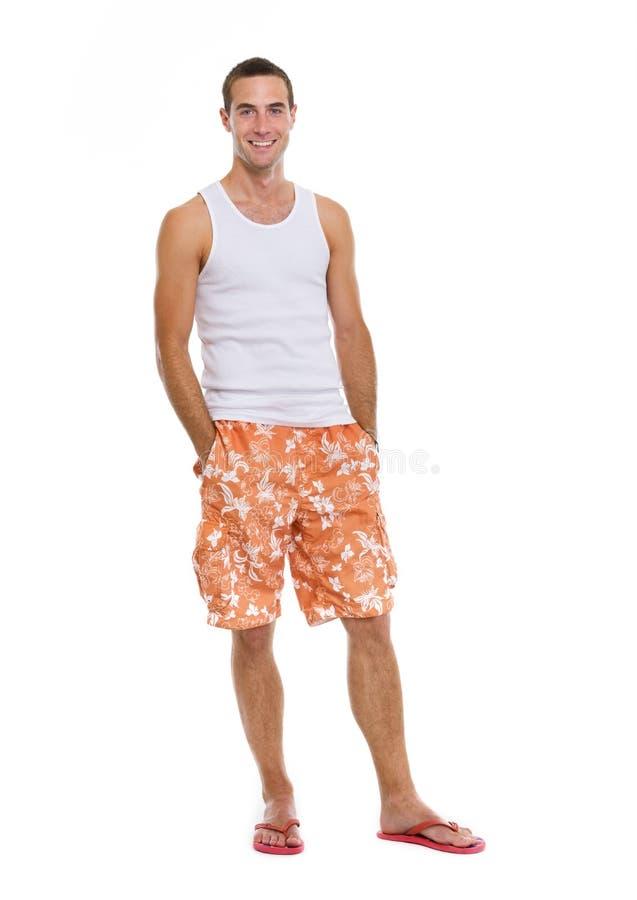 Retrato cheio do comprimento no homem das férias nos shorts fotos de stock royalty free