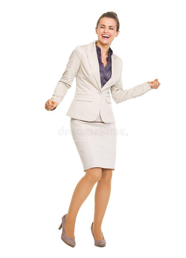 Retrato completo do comprimento da dança feliz da mulher de negócio foto de stock