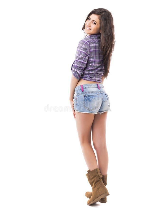 Retrato completo do comprimento da forma vestindo do adolescente bonito foto de stock