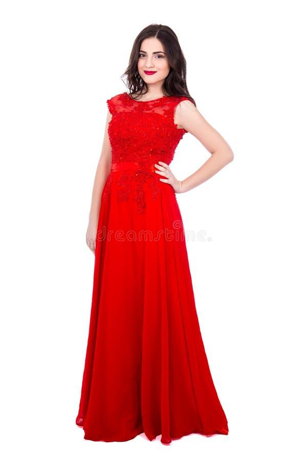 Retrato completo do comprimento da mulher bonita nova no isola vermelho do vestido foto de stock royalty free