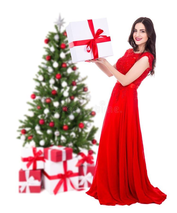 Retrato completo do comprimento da mulher bonita nova no vestido vermelho com fotografia de stock
