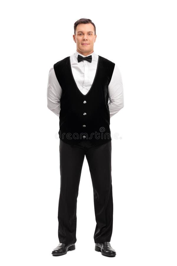Retrato completo do comprimento de um garçom masculino alegre foto de stock royalty free