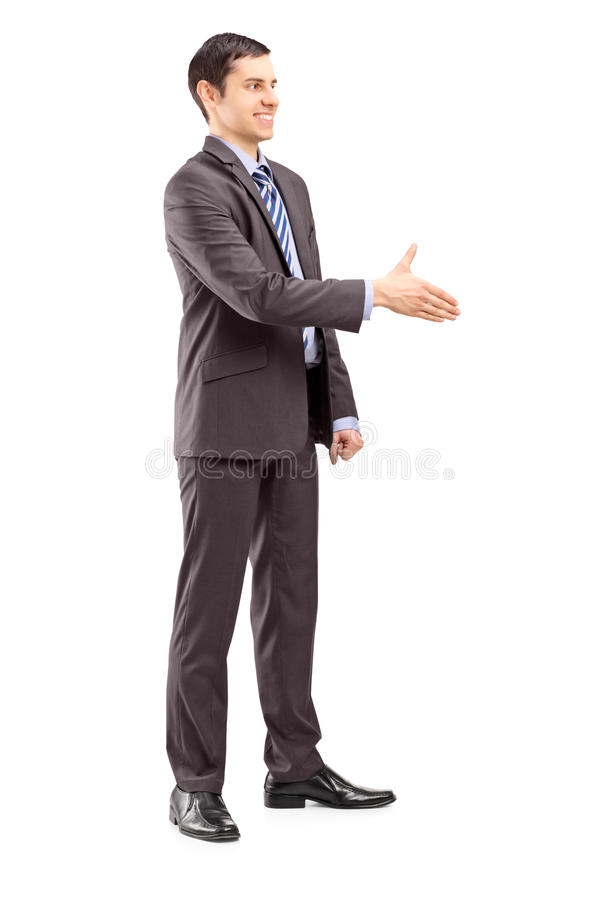 Retrato completo do comprimento de um homem de negócios novo que agita a mão foto de stock royalty free