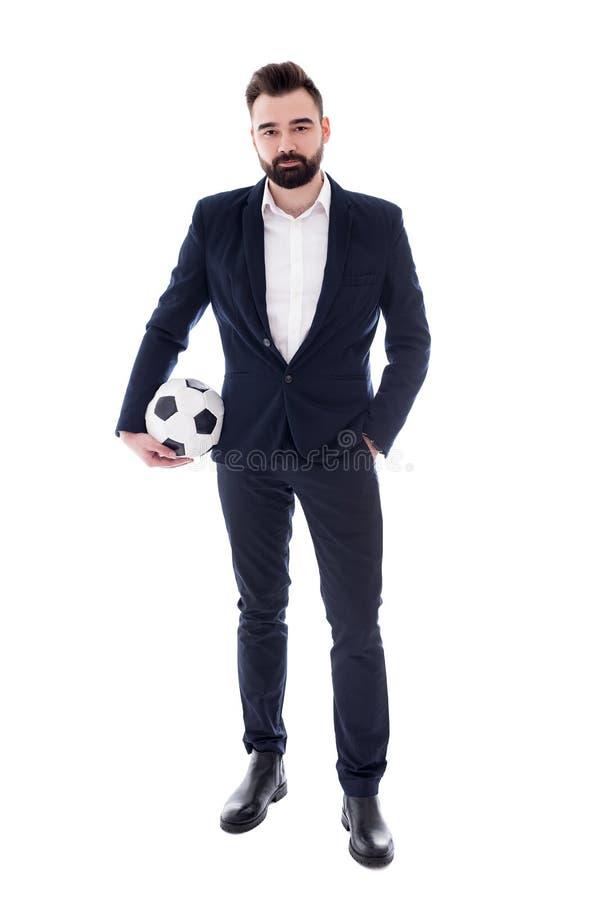 Retrato completo do comprimento do homem de negócios farpado considerável novo com a bola de futebol isolada no branco fotos de stock royalty free