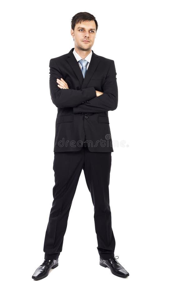 Retrato completo do corpo do homem de negócio novo com os braços dobrados fotos de stock