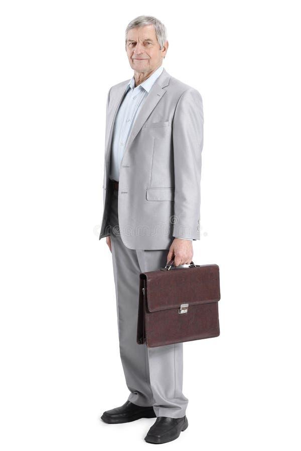 Retrato completo um homem de negócios bem sucedido com uma pasta de couro fotos de stock