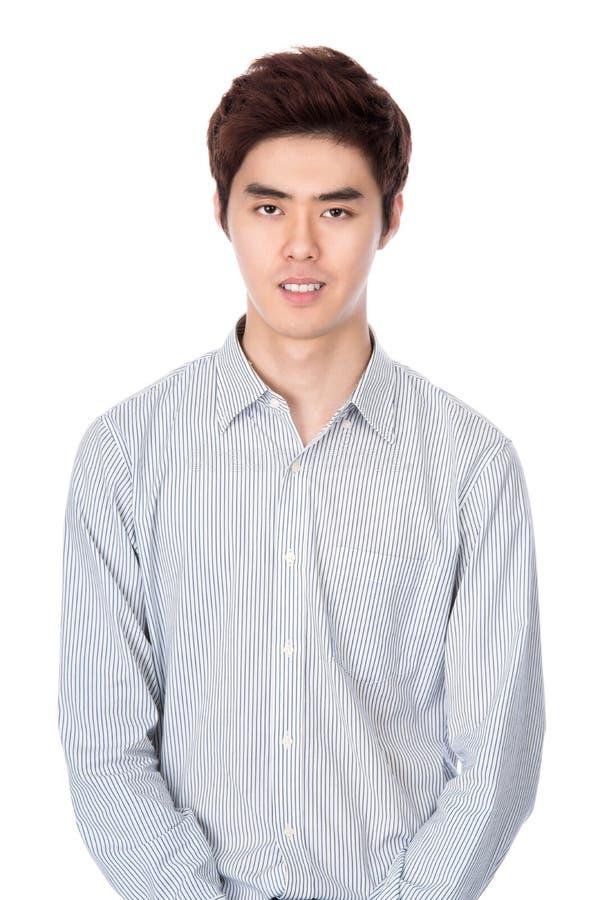Retrato coreano asiático do leste do estúdio do homem novo imagem de stock