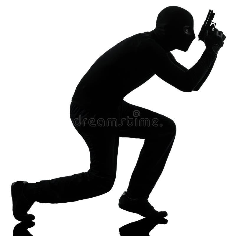 Retrato criminal del arma de la explotación agrícola del terrorista del ladrón imágenes de archivo libres de regalías