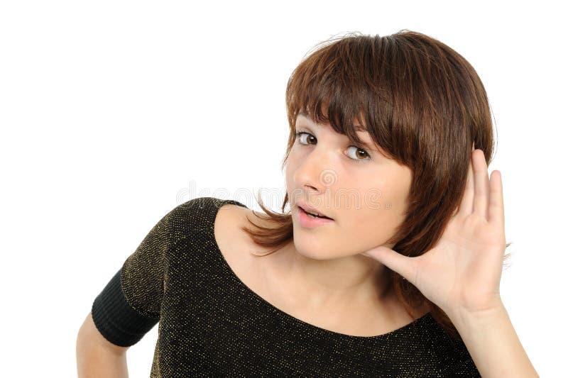 retrato da bisbolhetice de escuta da mulher nova imagens de stock royalty free