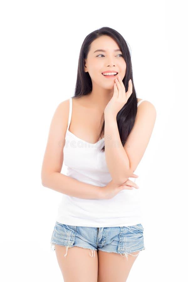 Retrato da composição asiática bonita da mulher do cosmético, do mordente do toque da mão da menina e do sorriso atrativos imagem de stock