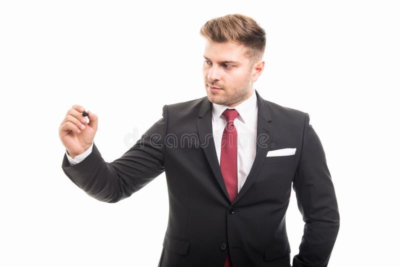 Retrato da escrita do homem de negócio com marcador preto imagens de stock royalty free