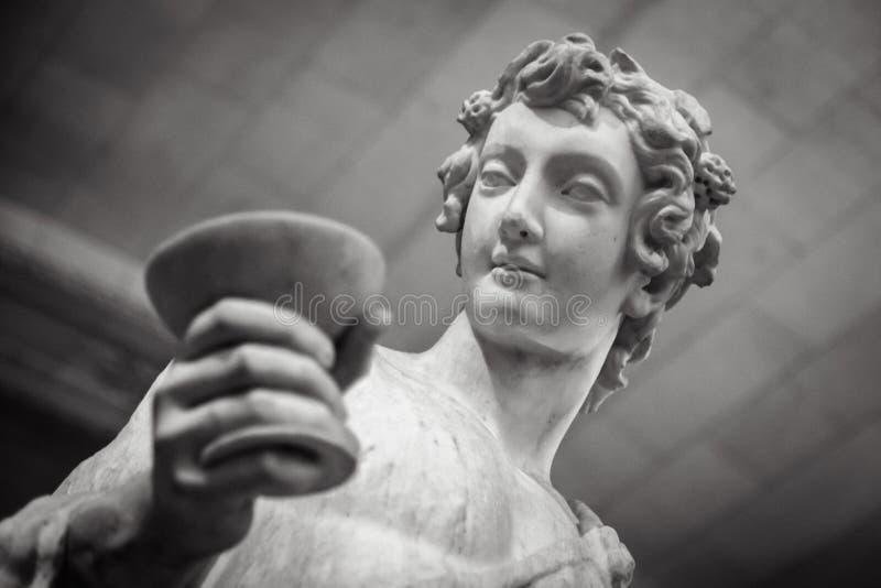 Retrato da estátua de Dionysus Bacchus Wine no Louvre imagens de stock royalty free