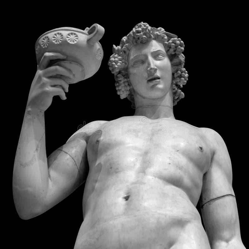 Retrato da estátua de Dionysus Bacchus Wine no preto fotografia de stock