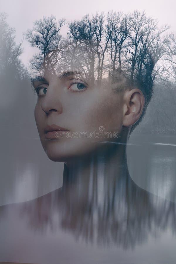Retrato da exposição dobro de uma jovem mulher bonita imagens de stock royalty free