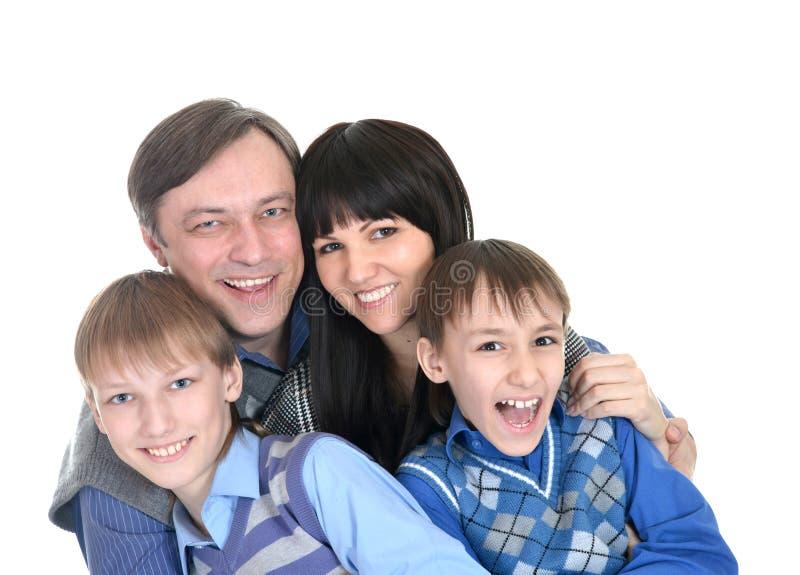 Retrato da família de quatro pessoas alegre fotografia de stock