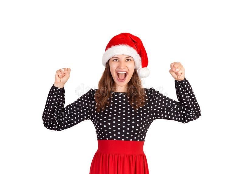 Retrato da gritaria temivelmente e espremendo a menina aumentada do fistsg, sendo muito entusiasmado menina emocional no chapéu d fotos de stock royalty free