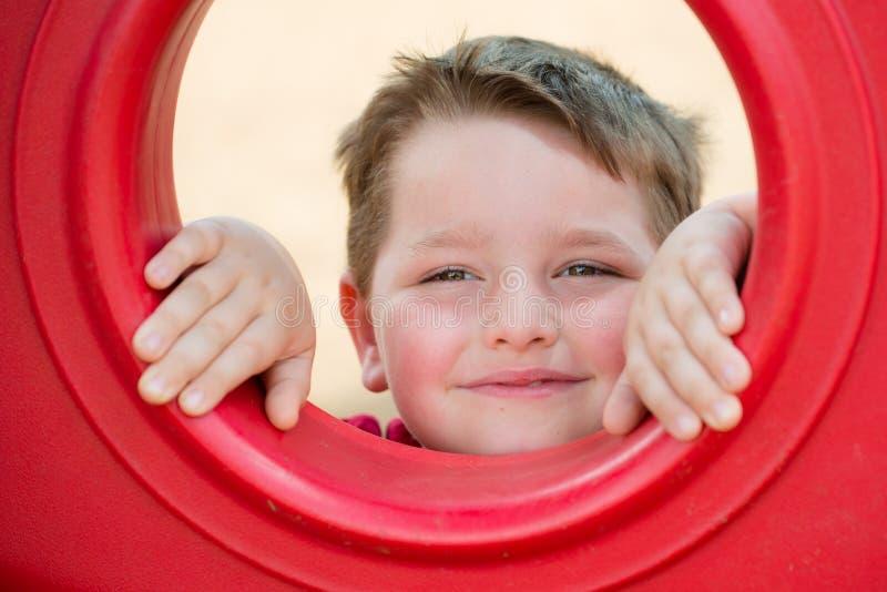 Retrato da jovem criança no campo de jogos imagens de stock royalty free