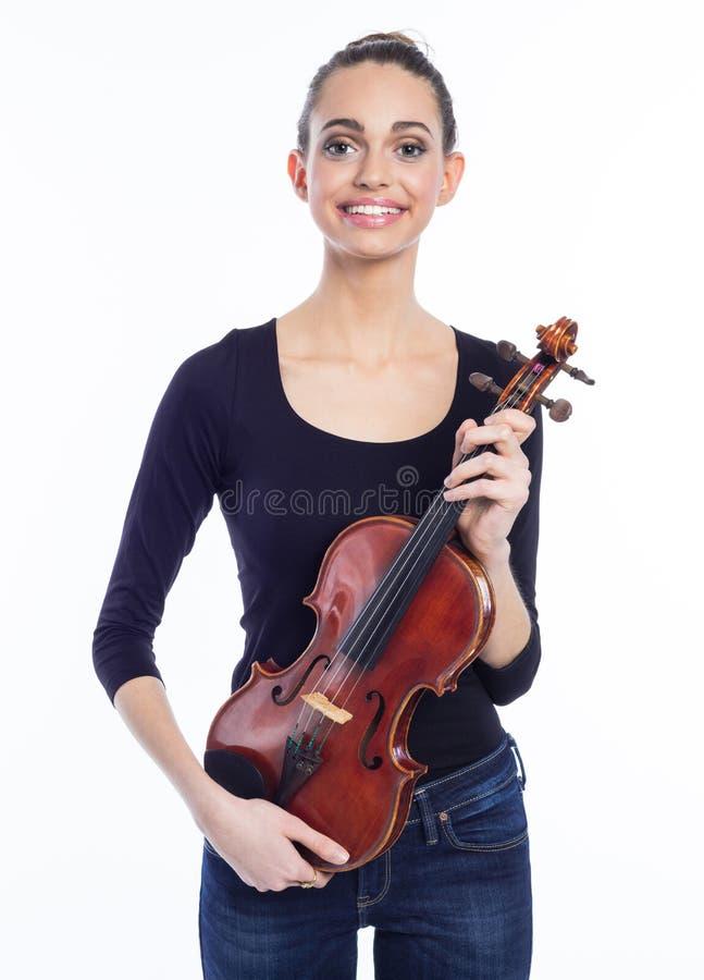 Retrato da jovem mulher feliz que guarda o violino fotos de stock royalty free