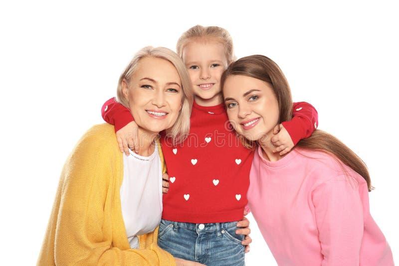 Retrato da jovem mulher, da sua filha e da mãe madura foto de stock