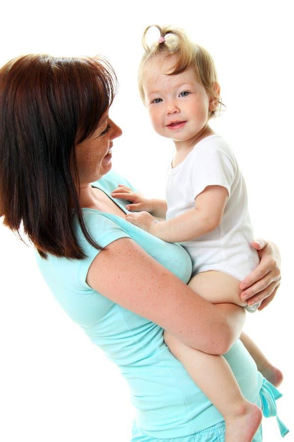 Retrato da matriz feliz com bebê fotografia de stock royalty free