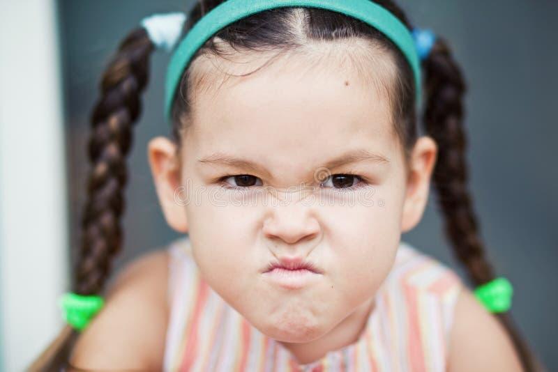 Retrato da menina asiática irritada imagens de stock royalty free
