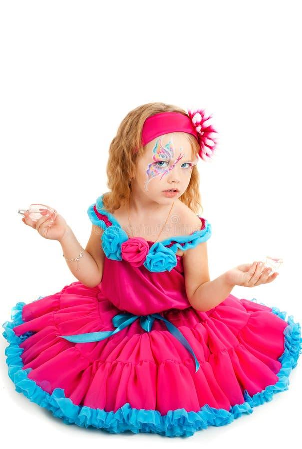 Retrato da menina bonita em um vestido vermelho foto de stock royalty free