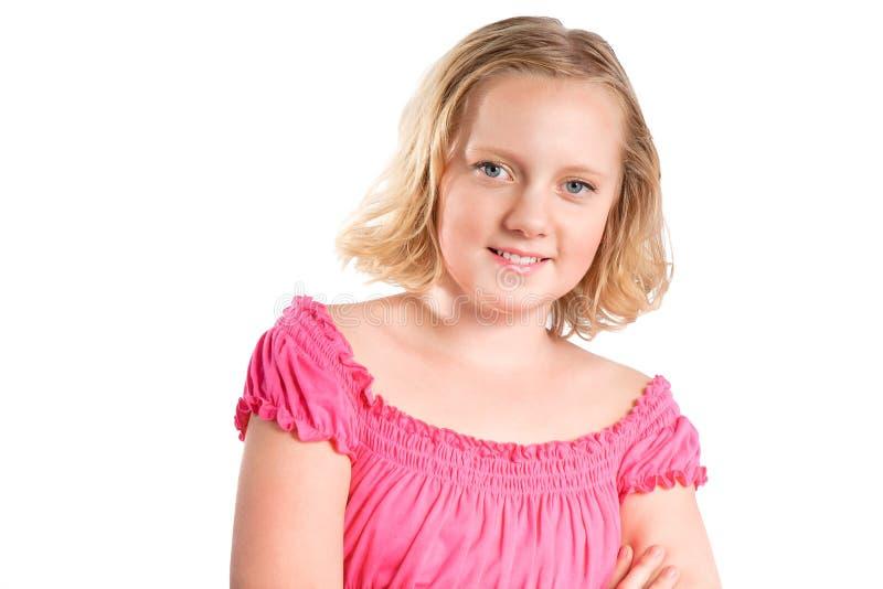 Retrato da menina de sorriso do preteen sobre o branco foto de stock royalty free