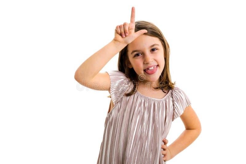 Retrato da menina feliz que faz o gesto de m?o do vencido na c?mera fotografia de stock