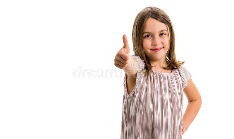 Retrato da menina feliz que faz os polegares acima do gesto na c?mera fotografia de stock