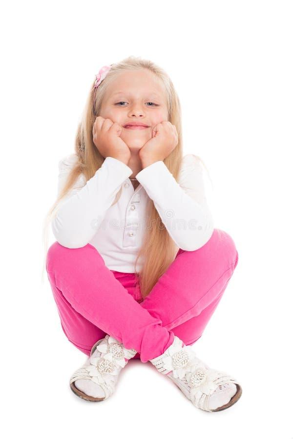 Retrato da menina loura em calças de brim cor-de-rosa fotografia de stock royalty free