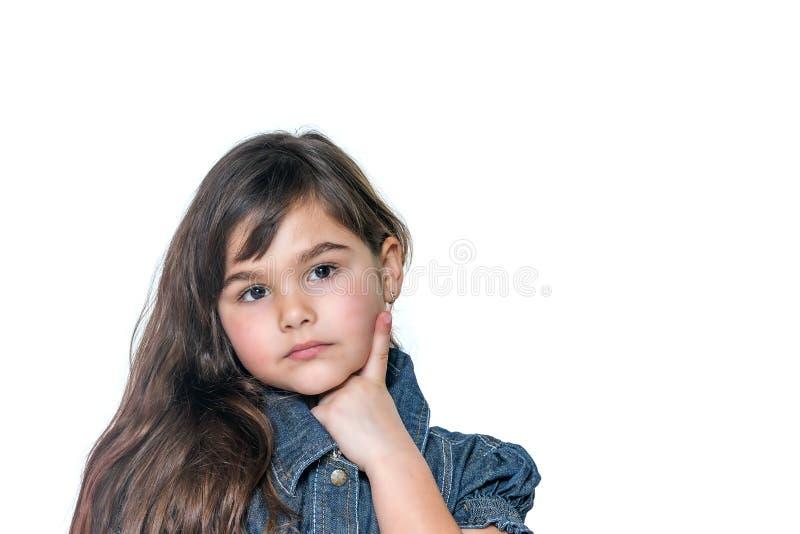 Retrato da menina pensativa isolado no backgro branco fotografia de stock royalty free