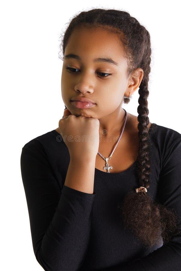 Retrato da menina preta triste no fundo branco fotografia de stock royalty free