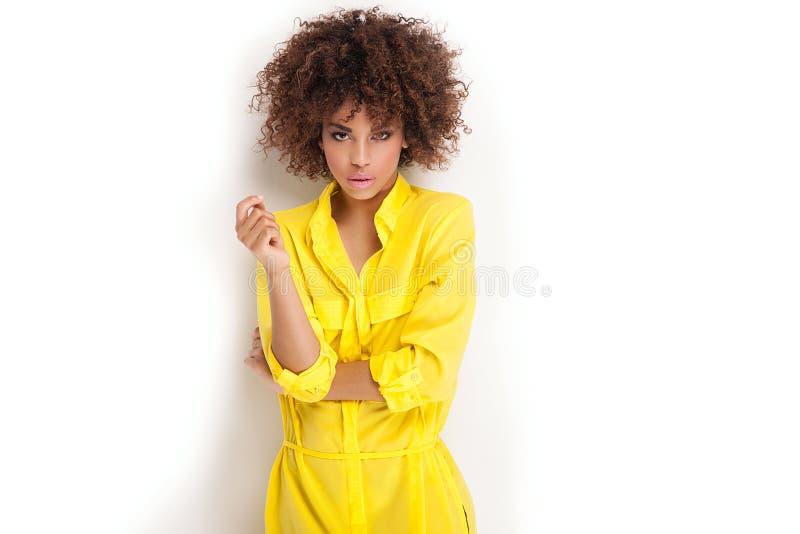 Retrato da moça com afro fotografia de stock royalty free