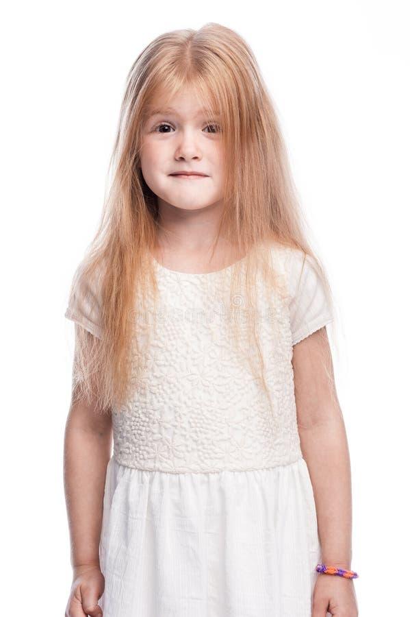 Retrato da moça que olha um pouco ansioso fotografia de stock royalty free
