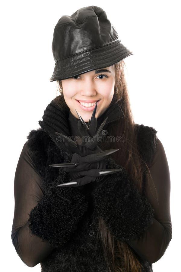 Retrato da morena nova de sorriso nas luvas com garras imagem de stock royalty free